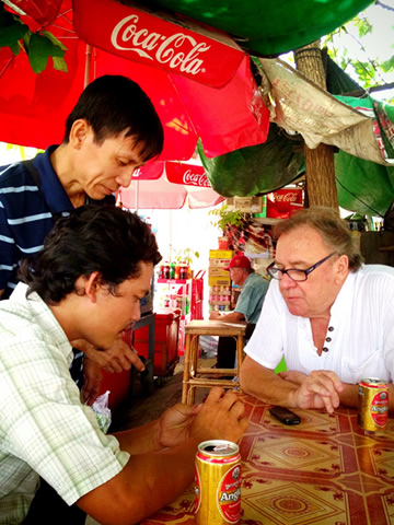Bill sharing  Ankor beers at a street cafe in Phnom Penh